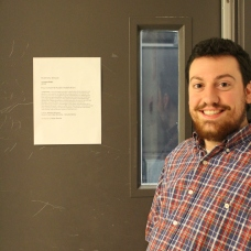 Matt near the entrance of the installation with museum label.