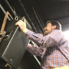 Matt installing a speaker being used in remember.